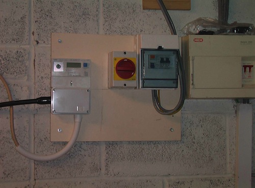 customer example installing solar panels on our roof you can see the other end of the armoured cable going into the junction box below the generation meter the red switch is the ac isolator